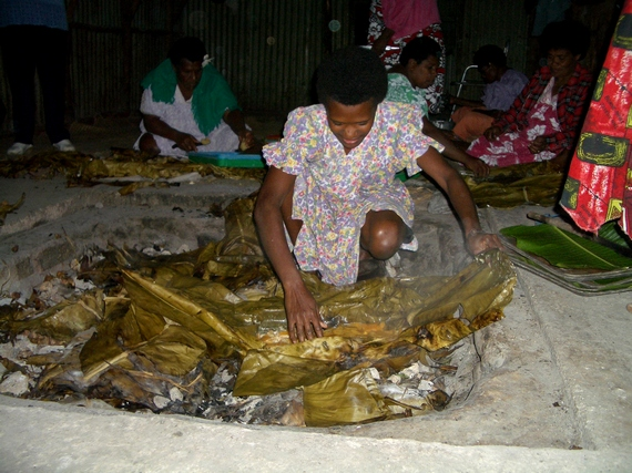Preparing traditional Vanuatu 'earth oven' meals