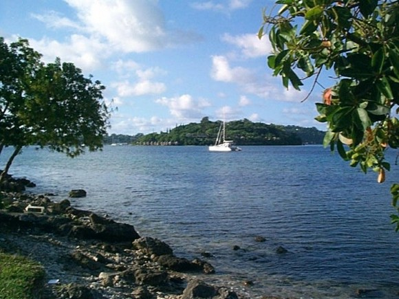 A yacht in Port Vila harbour, in front of Iririki Island